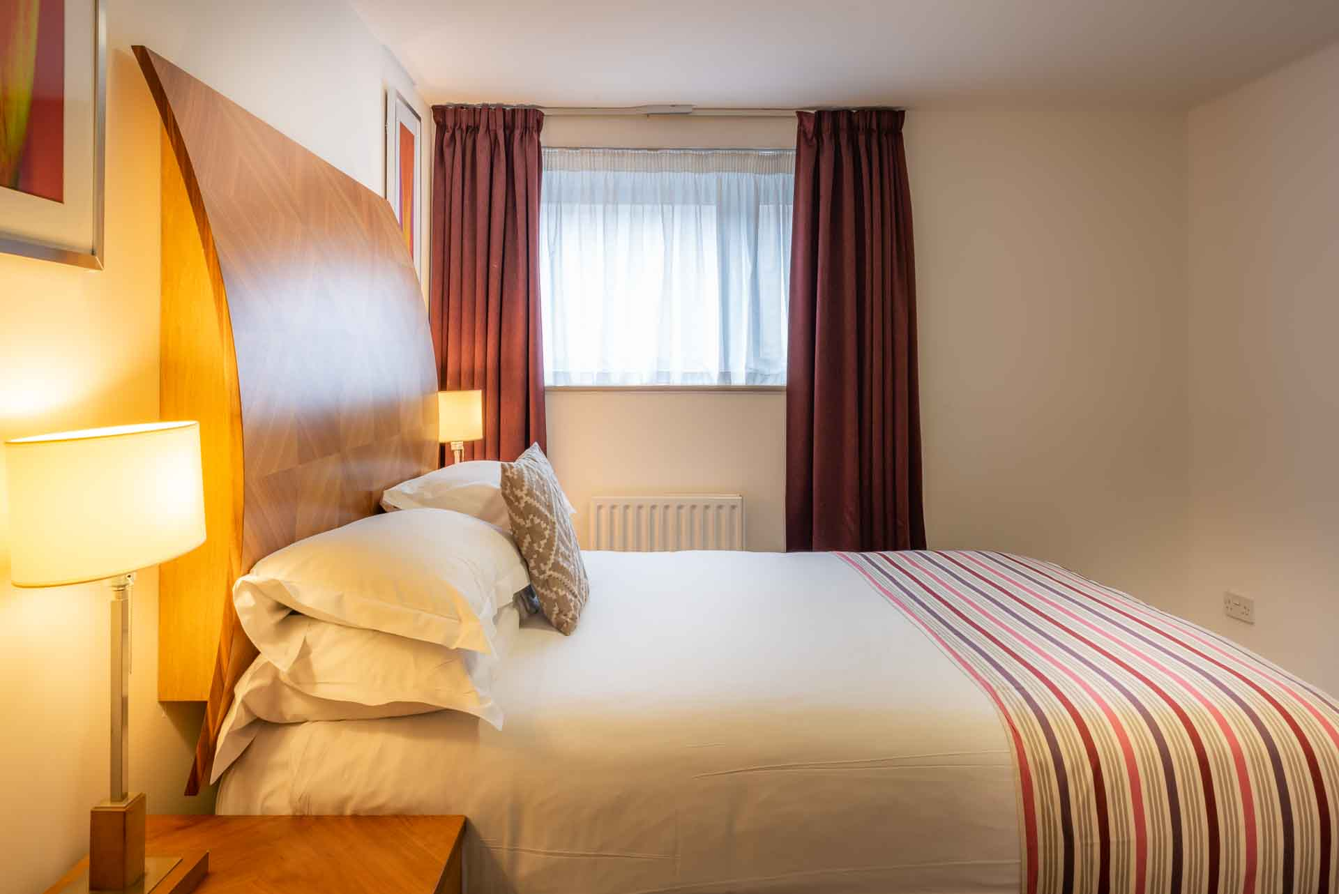 Comfortable-bright-bedroom-at-PREMIER-SUITES-Newcastle