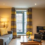 Comfortable-sofa-to-relax-with-TV-at-PREMIER-SUITES-Newcastle