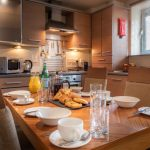Fully-equipped-kitchen-set-for-breakfast-at-PREMIER-SUITES-Newcastle