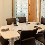 PREMIER-SUITES-Manchester-meeting-room-set-up-with-notepads