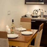 PREMIER-SUITES-Manchester-two-bedroom-dining-area